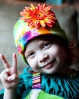 Rainbow Tie Dye Hat with Orange Daisy